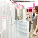 woman buys the refrigerator in shop